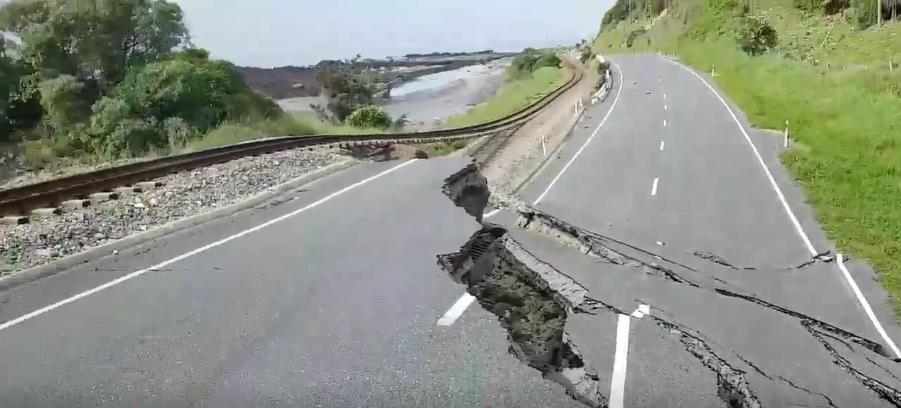 Road is nearly cut in half due to NZ temblor.